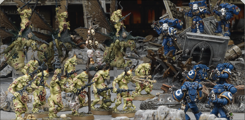 Plaguebearers attacking Space Marines